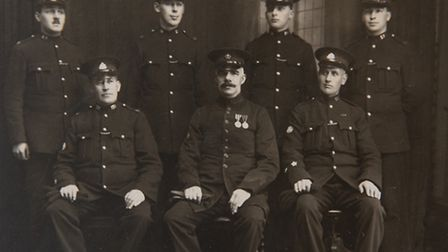 Inspector Charles Arthur Norman with other members of the police team.