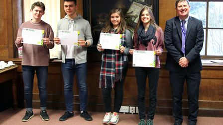 Students, with Paston College principal Kevin Grieve (right), after receiving their first aid certif