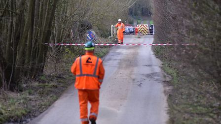 Contractors at the site of a Crane crash on Hill road near Wangford.PHOTO: Nick Butcher