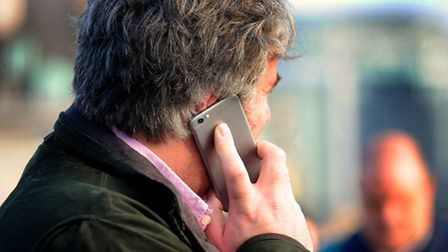Embargoed to 0001 Monday July 6File photo dated 19/11/14 of a man using a mobile phone as people a