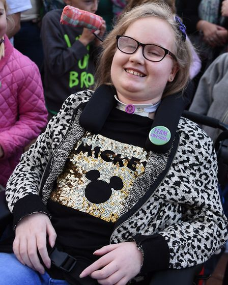 A big smile as 11-year-old Maisie Lossau is at home in Spixworth after she has spent the last eight