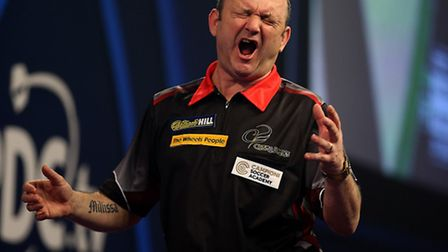 Darren Webster reacting during day twelve of the William Hill World Darts Championship at Alexandra