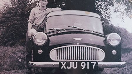 David Fairhead with his three-wheeler Bond Minicar which he could drive on a motorcycle licence. Pic