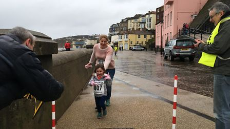 Stacey-Ann Clarke-Jenner, four, and her grandma Shelley Burton about to run through the 'Finish' lin