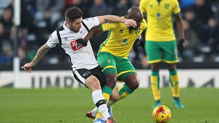 Norwich City midfielder Youssouf Mulumbu is back in contention for the New Year's Eve trip to Brentf