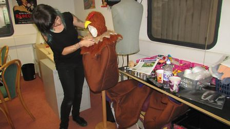 Costume designer Kirsteen Wythe puts the finishing touches to one of the panto babes costumes.