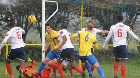 Norwich United, yellow, in action against Witham Town at Plantation Park. Picture: DENISE BRADLEY