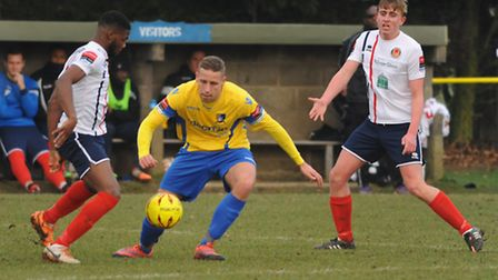 Lee Mason for Norwich United, yellow, in action against Witham Town at Plantation Park. Picture: DEN