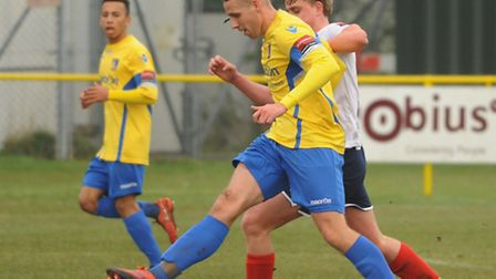 Lee Mason, front, and Nathan Stewart for Norwich United, yellow, in action against Witham Town at Pl