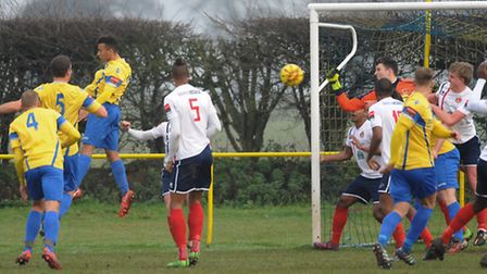 Norwich United, yellow, in action against Witham Town at Plantation Park. Witham Town goalkeeper San
