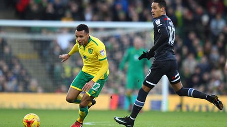 Jacob Murphy of Norwich and Thomas Ince of Derby County in action during the Sky Bet Championship ma
