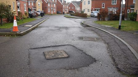 Unfinished roads and temporary ramps in Redpoll Road on the Queen's Hills estate, which should be co
