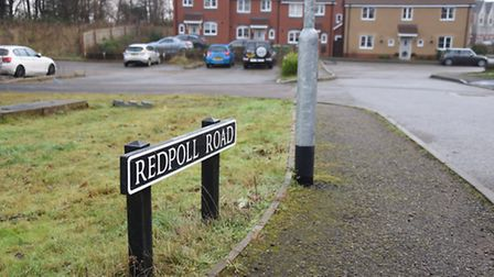 Redpoll Road which has unfinished roads and noisy manhole covers on the Queen's Hills estate, which