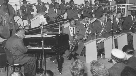 Count Basie, seen playing the piano, with his orchestra during a performance at the Samson and Hercu