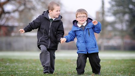 Blake Barley (4) walking with best friend Charlie King (4) at Toftwood Infant School, 12 months afte