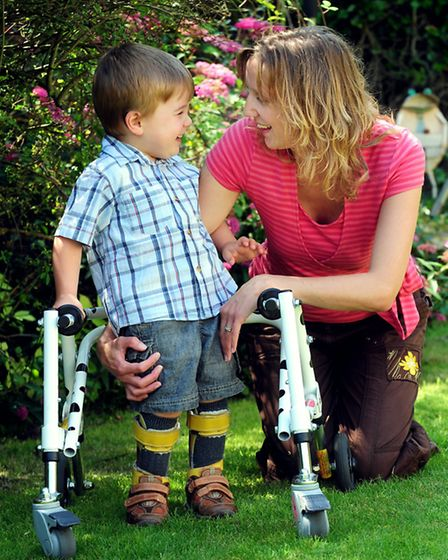 Blake Barley in the garden with his mum Debbie. The three-year-old has cerebral palsy, and his paren