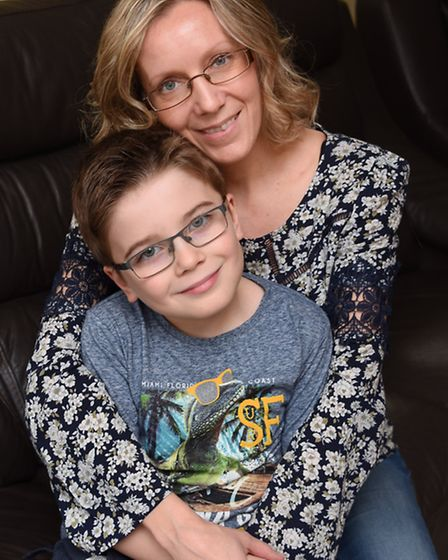 Blake Barley, eight, with his mum, Debbie, as they celebrate five years since his life-changing oper
