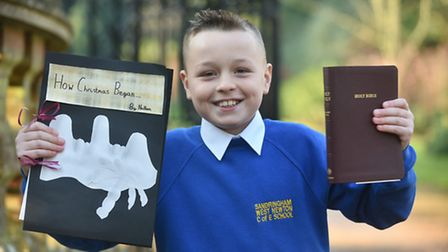 Nathan Taylor from Sandringham West Newton School receives his Bible from The Queen for his outstand