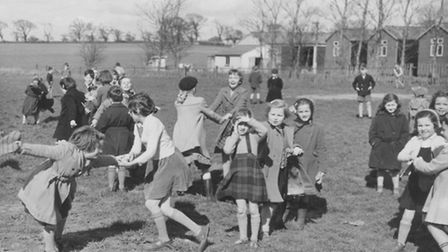 Hopton school children enjoying play time in March 1957. Picture Archant Library.