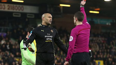 Carl Ikeme is sent off by referee David Coote for shoving Wes Hoolahan to the ground at Carrow Road.