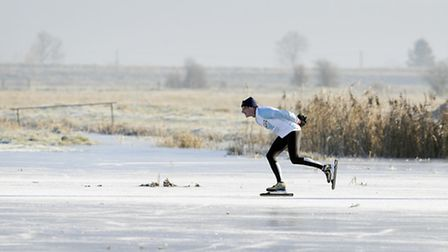 Fen Skaters take to the ice on the flooded fields around Welney, as conditions go below freezing.