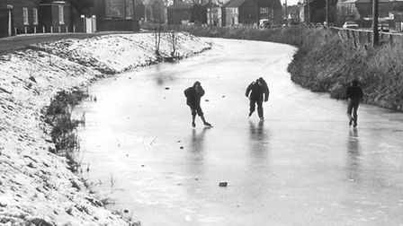 Crowds were out in large numbers on the Well Creek, Outwell, to enjoy ice skating on the frozen surf