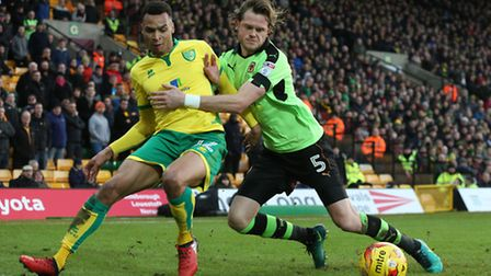 Jacob Murphy tussles for possession in Norwich City's 3-1 Championship win over Wolves. Picture by