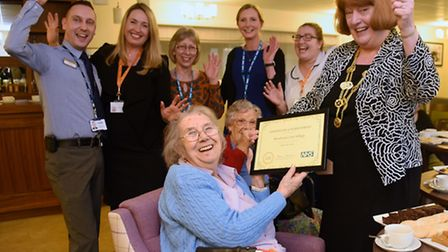 Resident Beryl Hemsley, 85, with the certificate of achievement presented by the Lord Mayor of Norwi