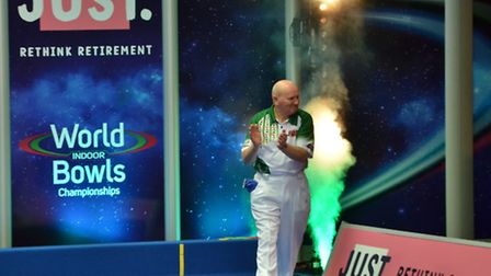 Charlie Bence enters the Potters arena to the accompaniment of fireworks. Photo: Potters Photo Wizar