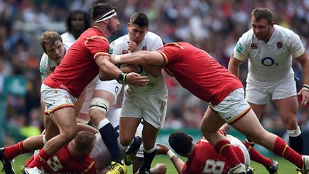 England's Ben Youngs, centre, is tackled by Wales' Rob Evans and Scott Baldwin during the Old Mutual