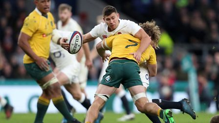 England's Ben Youngs is tackled by Australia's Michael Hooper during the Autumn International match