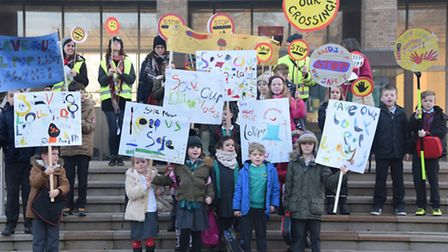 School children from Heacham join the protesters at County Hall against lollipop crossings being axe