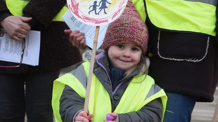 Elsie Cornish, three, joins protesters at County Hall against lollipop crossings being axed. Elsie's