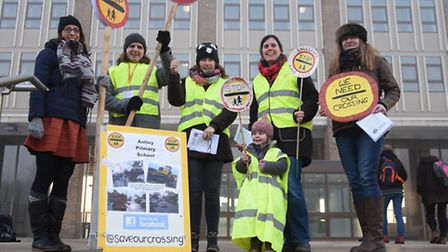 Protesters at County Hall against lollipop crossings being axed, including three mums, right, whose