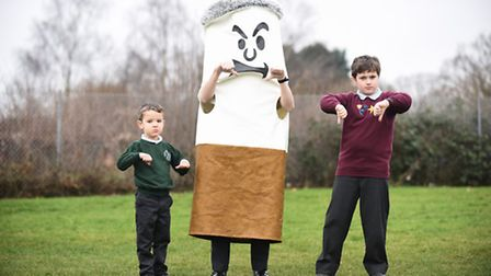 Dereham schools have some new smoke free zone signs. Pictured are Toftwood Infant School pupil Edwar