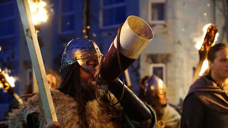 Sheringham Viking Festival torch lit parade through the town which ended with a ceremonial boat burn