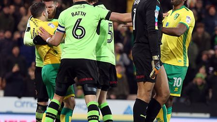Tempers flare and Matt Doherty of Wolverhampton Wanderers appears to head butt Wes Hoolahan of Norwi