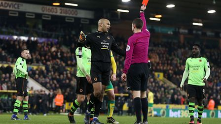 Carl Ikeme of Wolverhampton Wanderers is sent off by Referee David Coote after bringing down Wes Hoo