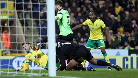 Carl Ikeme of Wolverhampton Wanderers brings down Wes Hoolahan of Norwich in the box and a penalty i