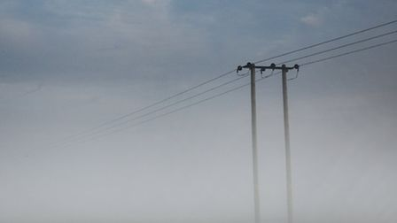 Fog covereing a field along the Acle straight. Picture: ANTONY KELLY