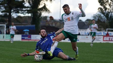 Rory McAuley for Lowestoft Town diving in for a challenge. Picture: Shirley D Whitlow