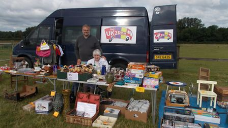 Jerry and Cathy Cuthbert, with some of their donated items.