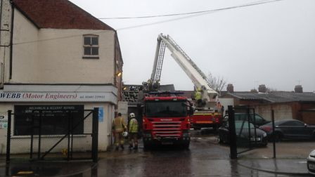 Firefighters are investigating the cause of a fire which broke out in a car workshop in Starling Roa