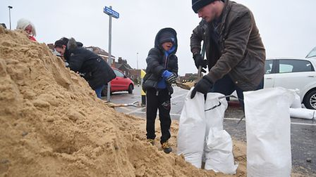 Great Yarmouth residents filling sandbags on Nelson Road North ahead of the high tide on Friday 13th