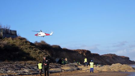 The scene at Thorpeness, as rescuers attempted to free a man trapped underneath a collapsed cliff. P