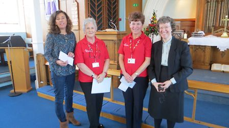 Church minister Revd Katy Dunn with representatives from the good causes