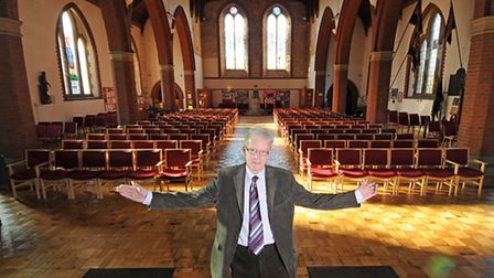 Churchwarden David Rivett is pictured at the unveiling of new chairs and refurbished flooring at St