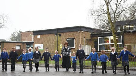 Mulbarton Infant and Junior Schools to merge. Headteacher Bev Theobold with some of the pupils.Pict