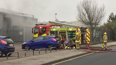 Lowestoft firefighters at the scene of the workshop unit blaze in Whapload Road. Picture: MICK HOWES