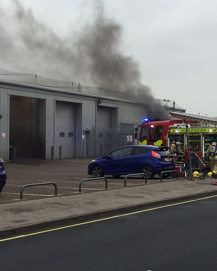 Fire crews from Suffolk and Norfolk tackle a minibus ablaze within a workshop on Whapload Road, Lowe